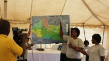STDM Team member presents the boundary maps of the 7 villages. ©UN-HABITAT/John Gitau