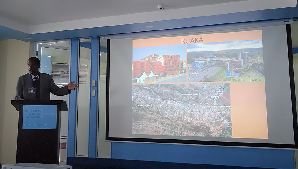 Director of the Town and County Planners Association of Kenya, Mr Mairura Omwega, discussing land markets in some of Nairobi's fringe counties such as Ruaka. Photo: UNHABITAT/Sina Schlimmer.