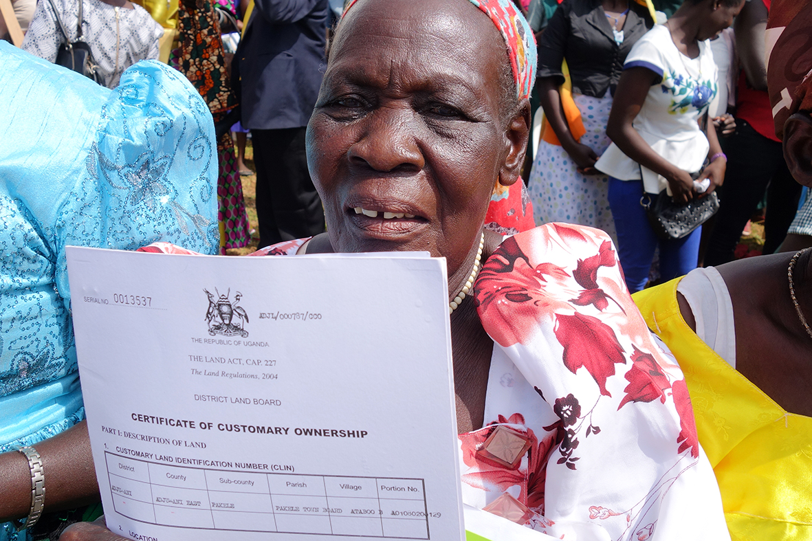 One of the beneficiaries in Adjumani showing her certificate during the issuance ceremony