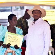 One of the beneficiaries receiving the certificate of customary ownership from the President of Uganda, H.E Yoweri Kaguta Museveni