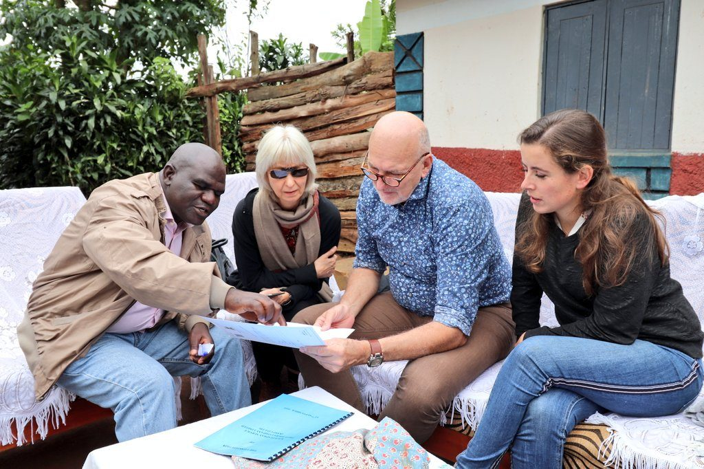 The delegation from the Embassy of the Kingdom of Netherlands in Uganda assess a Certificate of Customary Ownership issued in Kabale District.