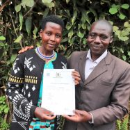 Mr. Nyesigyire Denis and Mrs. Nyesigire Sarah from Kabale District display their Certificate of Customary Ownership issued under the GLTN initiative funded by the Netherlands government