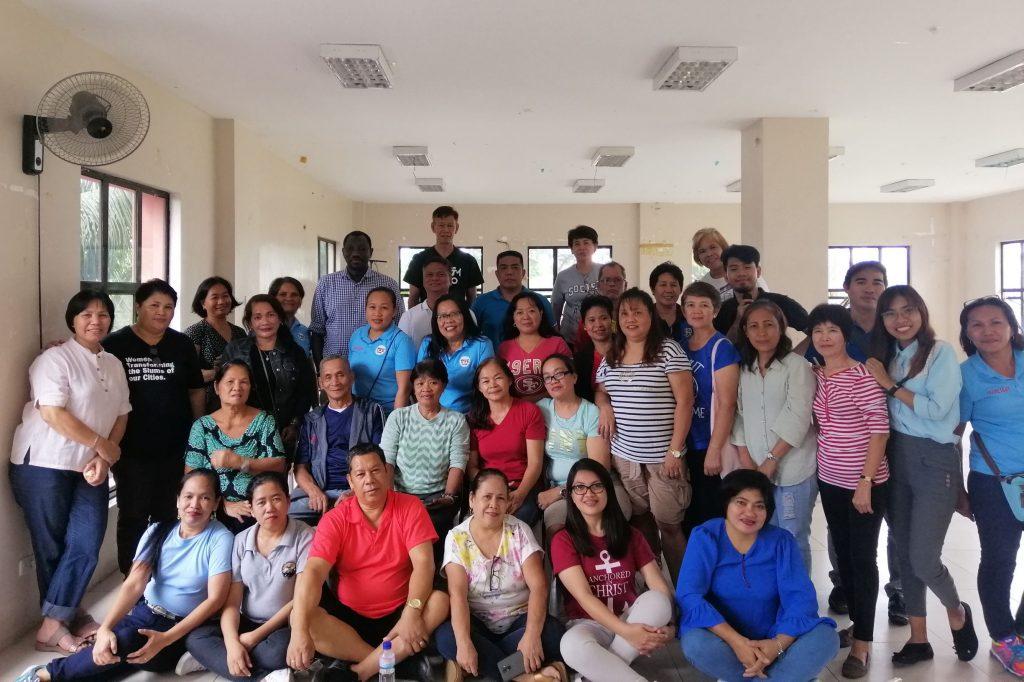 Mr. Oumar Sylla with leaders from the eight Barangays in Muntinlupa. Photo credit: UN-Habitat/Lunalyn Cagan