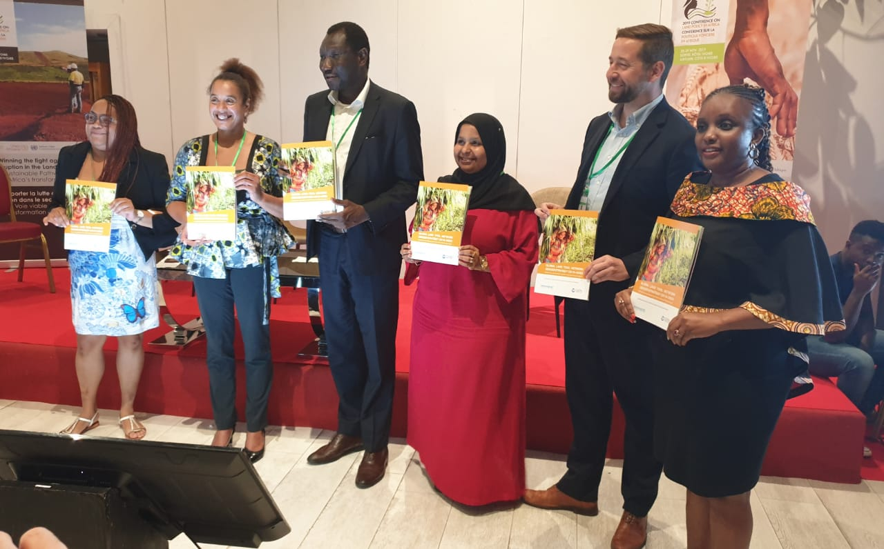 Land and GLTN Unit Leader Oumar Sylla (third from left) displaying copies of the GLTN Gender Strategy (2019-2030) with some of the GLTN partners who participated at the launch.