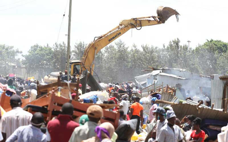 An excavator tears into houses in Kajiji, Sewage area of Kariobangi North, May 4, 2020. Photo: Elvis Ogina www.standardmedia.co.ke