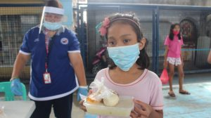 Underweight children under the age of 12 receiving supplemental feeding during the community quarantine to sustain their nutritional needs, a community-based intervention in Valenzuela (photo c/o of HPFPI Valenzuela)